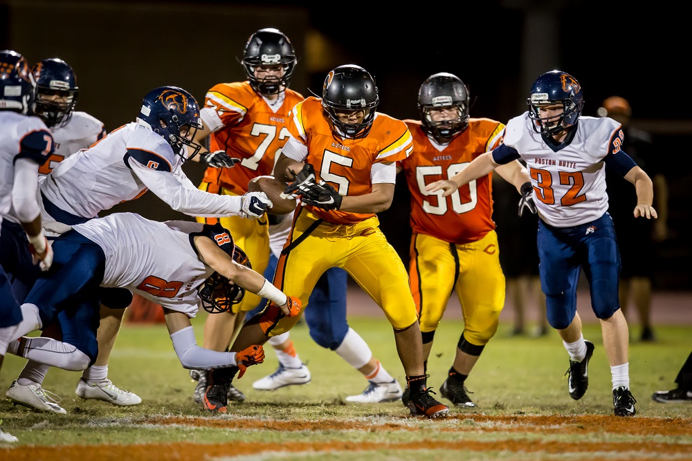 Poston Butte's Chase Taylor (6) strips the ball from Corona del Sol's Cameron Brice (5) during the football game between Corona del Sol and Poston Butte on Friday, October 2, 2015.