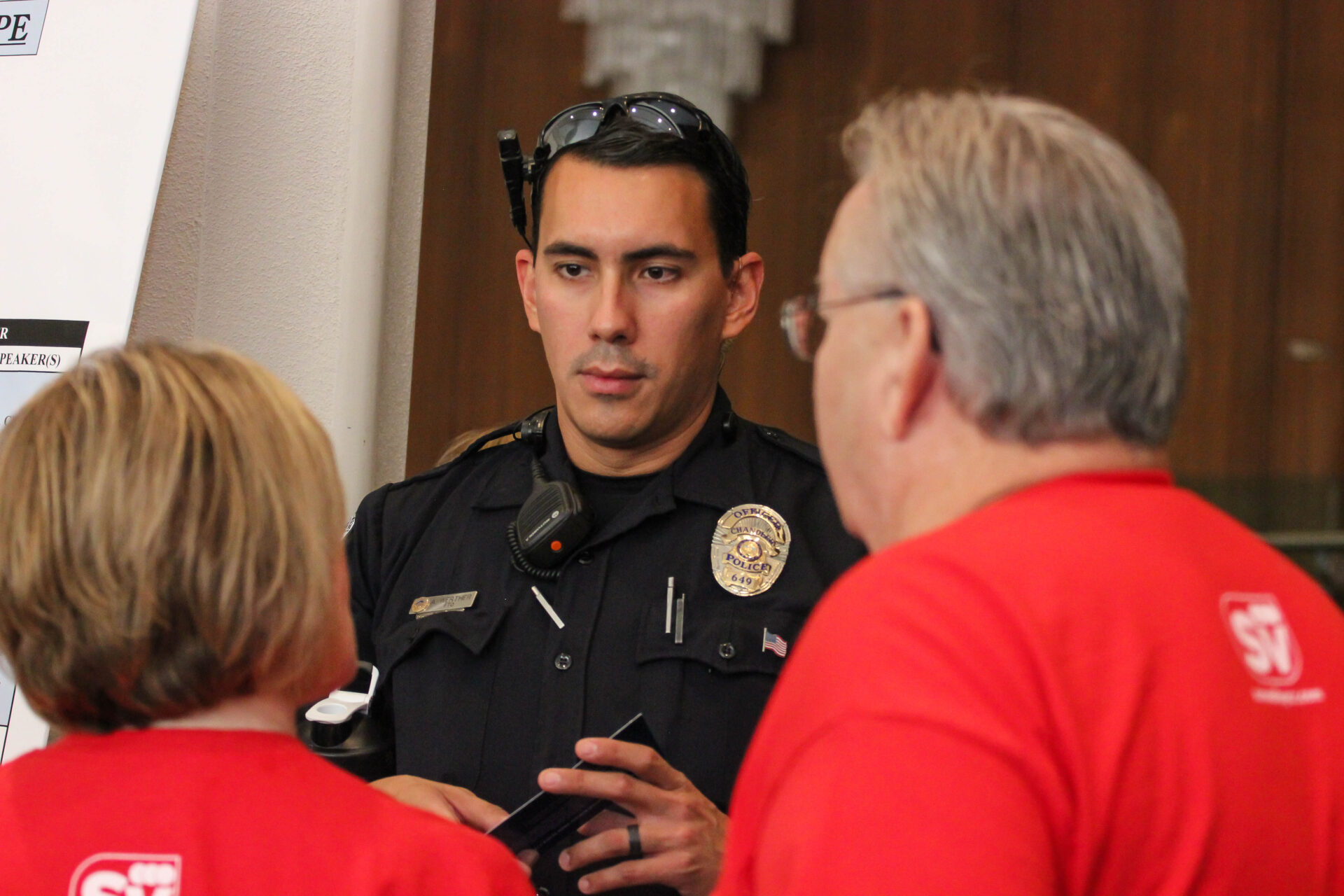 Officer Ariel Werther talked with conference-goers.  (Wrangler News photo by Alex J. Walker)