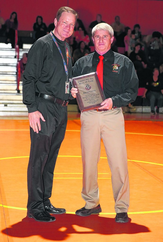 Retired Corona wrestling coach Dave Vibber, right, was inducted into the Aztec Hall of Fame by current athletic director Dan Nero. (Photo by Kris Cartwright for Wrangler News)