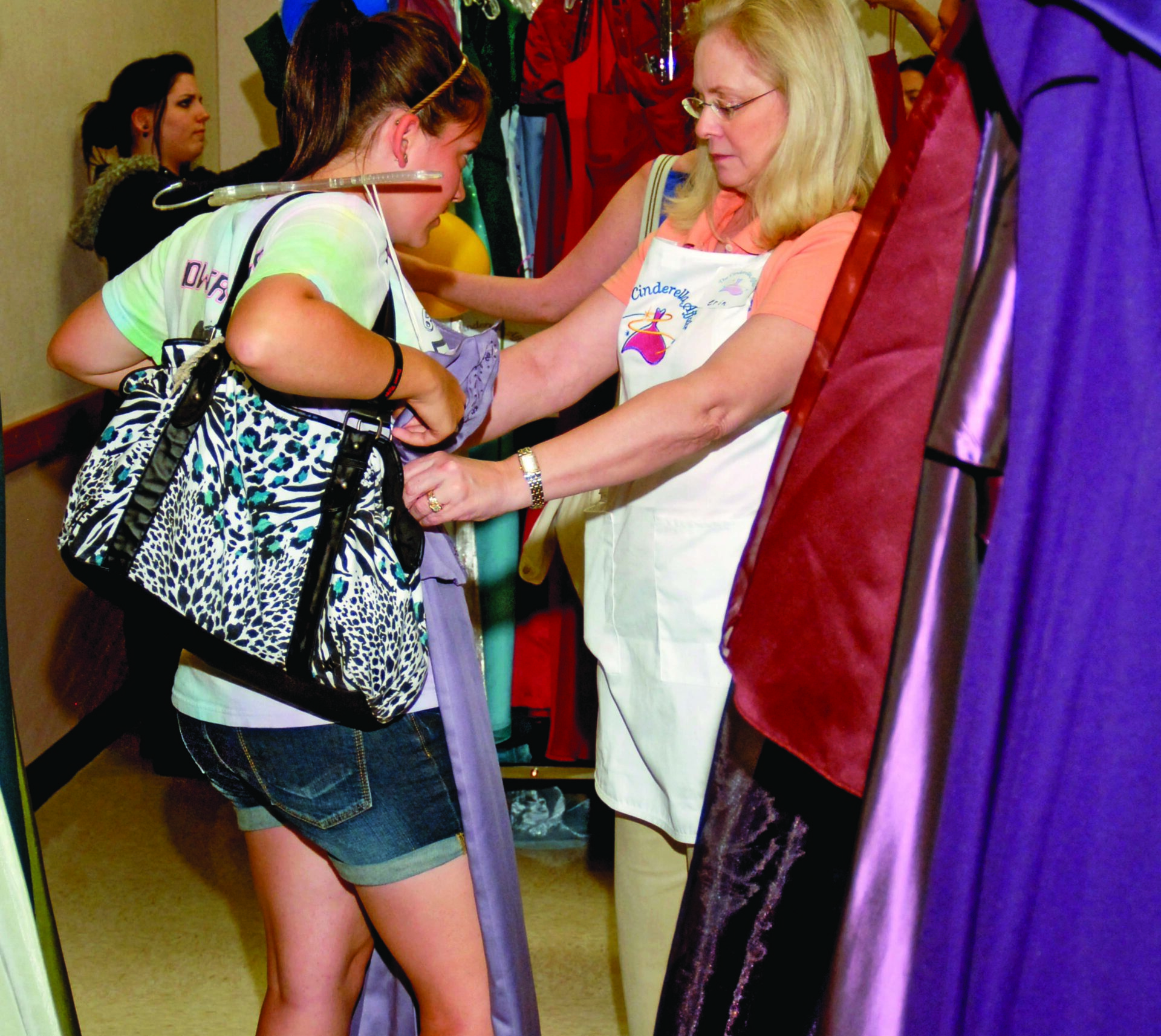 "Gowns come out of the closet to give needy girls their night as ""Cinderella"""