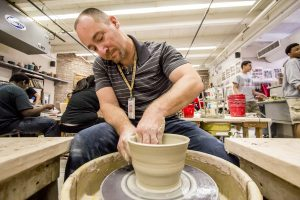 Fine arts instructor Jasen Evoy guided his Marcos de Niza High School ceramics students in a class project to create handmade bowls for the annual effort to generate funds for Tempe Community Action Agency. [Billy Hardiman/Wrangler News]