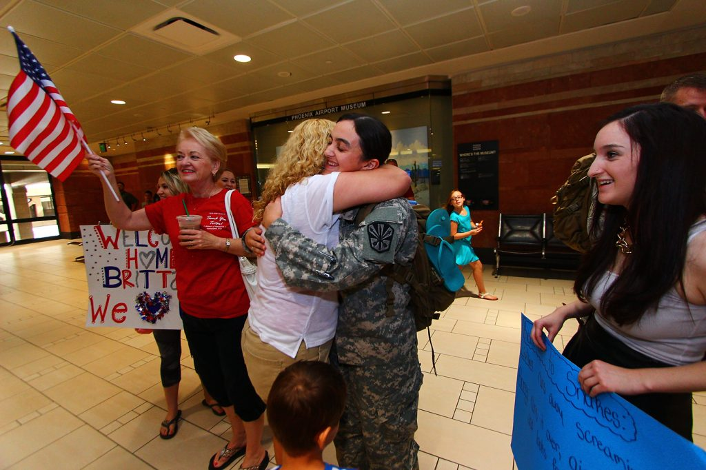 Family, friends and even strangers gave a heartfelt welcome to Arizona National Guard troops who arrived at Sky Harbor International Airport after nearly a year serving at Guantanamo Bay.