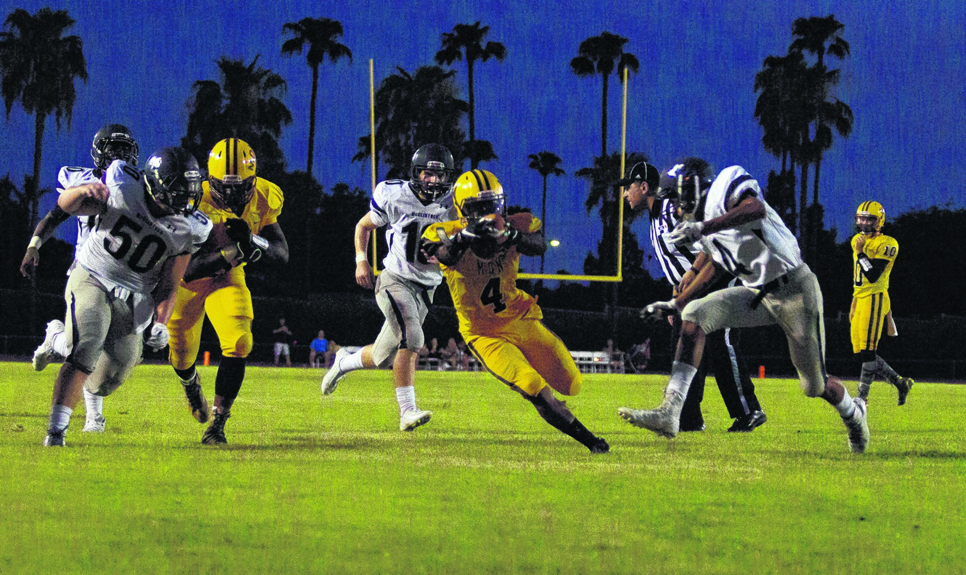 Marcos de Niza running back Shaun Richards (4) dives for a touchdown during a football game against McClintock on Friday, Aug. 28, 2015. Marcos de Niza takes a 49-7 win over McClintock.