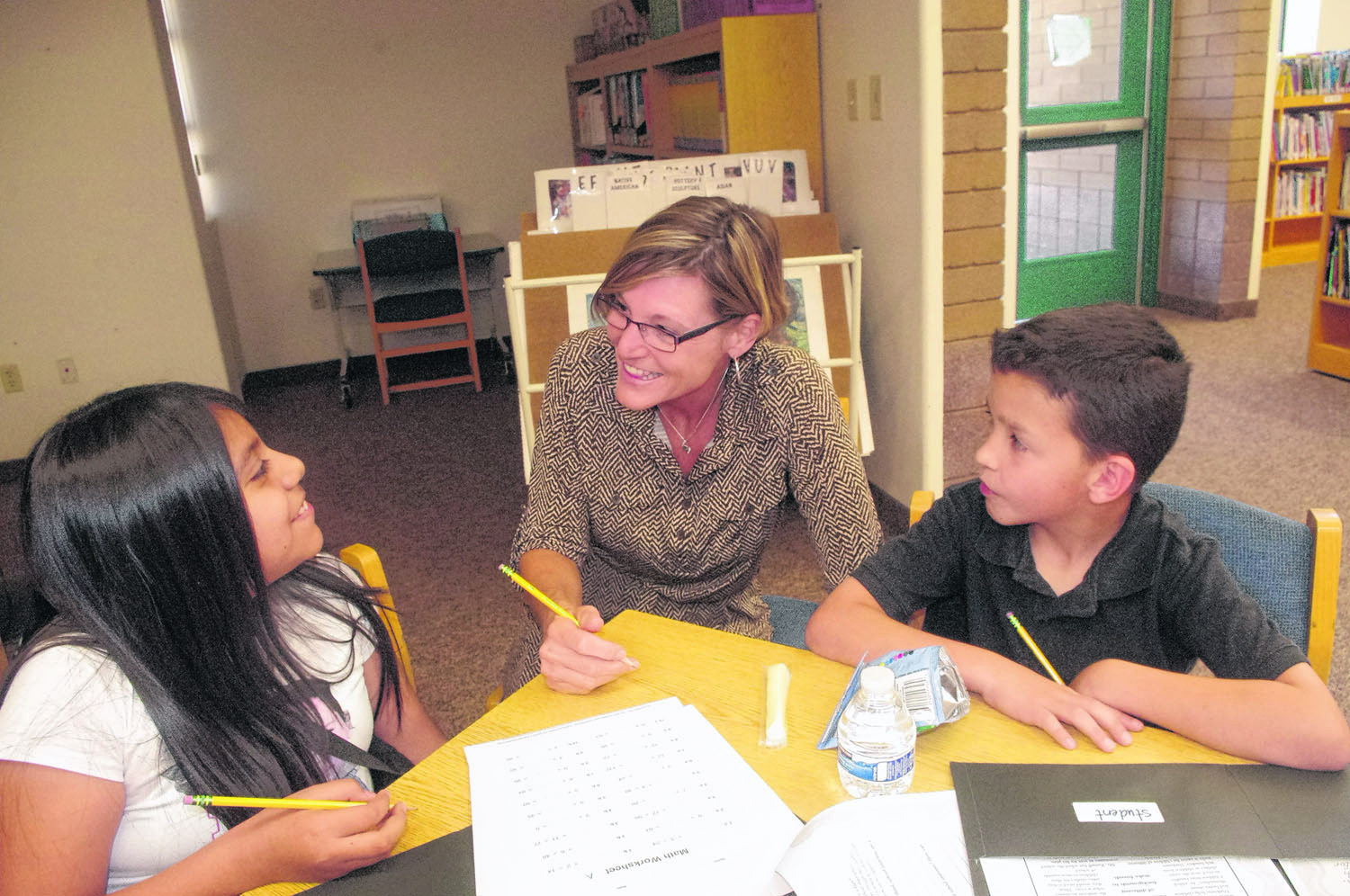 SRP volunteers boost students' confidence -and grades- at Hudson Elementary