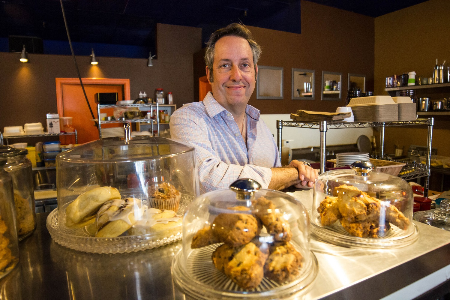 Coffee entrepreneur Steve Schmidt with just a few of the tasty treats he offers--with an even wider selection on the way. Wrangler News photo by Alex J. Walker