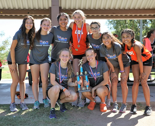 Corona's girls cross country team took third place at the annual Ojo Rojo Invitational Cross Country meet. Team includes, front row, from left: Riley Wright, Renee Payne; top row: Kristina Phillips, Mia Da Rosa, Andelina Thomas, Mackenzie Burgess, Bella Sarno, Abby Cordiak, Cybelle Cozart. (Photo by Andy Wylde for Wrangler News)