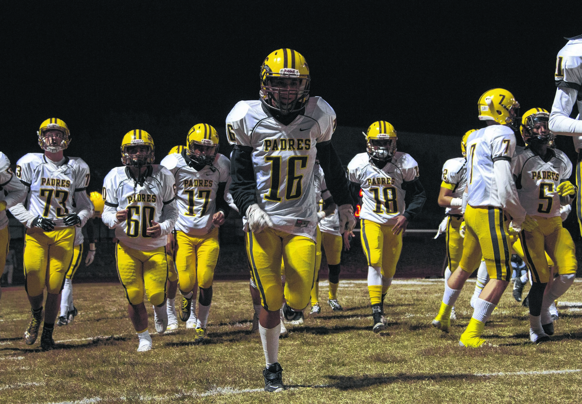Marcos de Niza players take to the field after halftime during a playoff game against Ironwood Ridge in Oro Valley on November 13, 2015. Padres defeat Nighthawks 35-15. Wrangler News photo by Ana Ramirez.