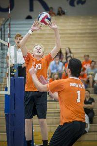Chris Davis sets the ball during a match against Mesquite. [Billy Hardiman/Wrangler News]