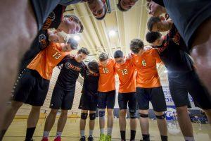 Aztecs gather in a pre-game prayer circle for their teammate. [Billy Hardiman/Wrangler News]