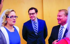 U.S. Rep. Kyrsten Sinema with Tempe Mayor Mark Mitchell, right, and Mitchell aide Tony Cani at a State of the District address Feb. 17 to members of the Tempe Chamber of Commerce. [Photo Joyce Coronel/Wrangler News]