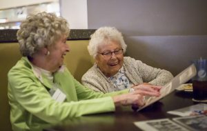 Marian Lober, 82, and Irene Groves, 92, teh Hanger sisters, both look back on memories from their Kyrene Elementary days. [Billy Hardiman/Wrangler News]
